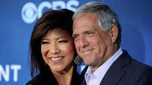 "In this June 16, 2014 file photo, Les Moonves, right, president and CEO of CBS Corporation, and his wife Julie Chen pose together at the premiere of the CBS science fiction television series ""Extant"" in Los Angeles. (Photo by Chris Pizzello/Invision/AP, File)"