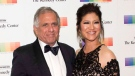 "In this Dec. 2, 2017 file photo, Les Moonves, left, and his wife Julie Chen arrive for the Kennedy Center Honors gala dinner in Washington. Chen was absent from her talk CBS show, ""The Talk'"" a day after a new round of sexual misconduct allegations against Moonves brought the departure of the CBS chief executive. (AP Photo/Kevin Wolf, File)"