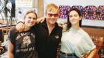 Elton John poses with Sonic Boom record store employees Lauren Mayer, left, and Ali Haberstroh in Toronto in this photo from Sonic Boom's twitter page. Elton John surprised employees at Toronto record shop Sonic Boom on Tuesday when he strolled into the store and bought a number of albums. THE CANADIAN PRESS/HO, @SonicBoomMusic, Twitter