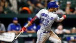 Toronto Blue Jays' Lourdes Gurriel Jr. singles in the seventh inning of a baseball game against the Baltimore Orioles, Tuesday, Sept. 18, 2018, in Baltimore. Reese McGuire and Teoscar Hernandez scored on the play. Toronto won 6-4. (AP Photo/Patrick Semansky)