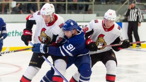 Toronto's John Tavares is checked by Ottawa's Logan Brown and Ryan Dzingel during the second period of the NHL pre-season game between the Maple Leafs and the Senators in Lucan, Ontario, Tuesday, September 18, 2018. THE CANADIAN PRESS/ Geoff Robins