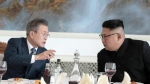 South Korean President Moon Jae-in, left, talks with North Korean leader Kim Jong Un at Okryu-Gwan restaurant in Pyongyang, North Korea, Wednesday, Sept. 19, 2018. Moon and Kim announced a sweeping set of agreements after their second day of talks in Pyongyang on Wednesday that included a promise by Kim to permanently dismantle the North's main nuclear complex if the United States takes corresponding measures, the acceptance of international inspectors to monitor the closing of a key missile test site and launch pad and a vow to work together to host the Summer Olympics in 2032.(Pyongyang Press Corps Pool via AP)