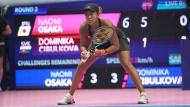 Naomi Osaka of Japan plays against Dominika Cibulkova of Slovakia during the second round match of Pan Pacific Open women's tennis tournament in Tokyo Wednesday, Sept. 19, 2018. (AP Photo/Eugene Hoshiko)