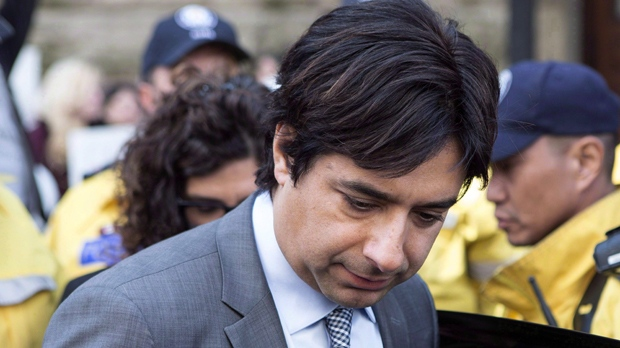 Former CBC radio host Jian Ghomeshi leaves a Toronto court after signing a peace bond, on Wednesday, May 11, 2016. An editor at the New York Review of Books has parted ways with the prestigious literary publication amid controversy over his decision to publish a personal essay by disgraced former radio host Jian Ghomeshi. THE CANADIAN PRESS/Chris Young