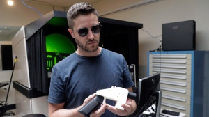 Cody Wilson, with Defense Distributed, holds a 3D-printed gun called the Liberator at his shop, Wednesday, Aug. 1, 2018, in Austin, Texas. A federal judge in Seattle  issued a temporary restraining order Tuesday to stop the release of blueprints to make untraceable and undetectable 3D-printed plastic guns. (AP Photo/Eric Gay)
