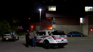Toronto police are seen investigating after a shooting took place outside of a public library in the city's Jane and Finch neighbourhood.