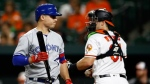 Toronto Blue Jays' Aledmys Diaz, left, walks off the field after striking out swinging, next to Baltimore Orioles catcher Austin Wynns during the second inning of a baseball game Wednesday, Sept. 19, 2018, in Baltimore. Baltimore won 2-1. (AP Photo/Patrick Semansky)