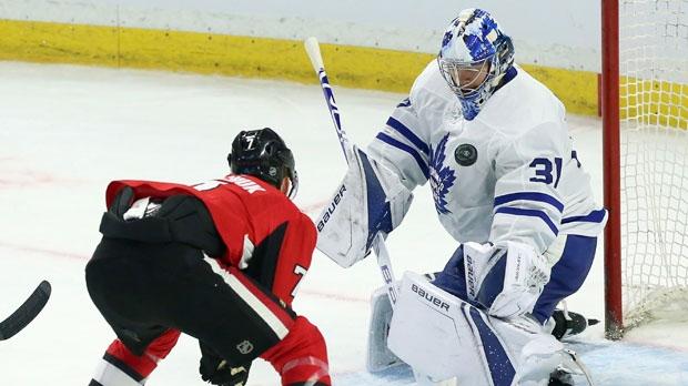Toronto Maple Leafs goaltender Frederik Andersen (31) block the puck as Ottawa Senators' Brady Tkachuk (7) the net during second period of NHL pre-season hockey in Ottawa on Wednesday September19, 2018. THE CANADIAN PRESS/Fred Chartrand