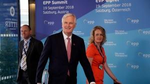 EU chief Brexit negotiator Michel Barnier, center, arrives at the informal EU summit in Salzburg, Austria, Wednesday, Sept. 19, 2018. (AP Photo/Matthias Schrader)