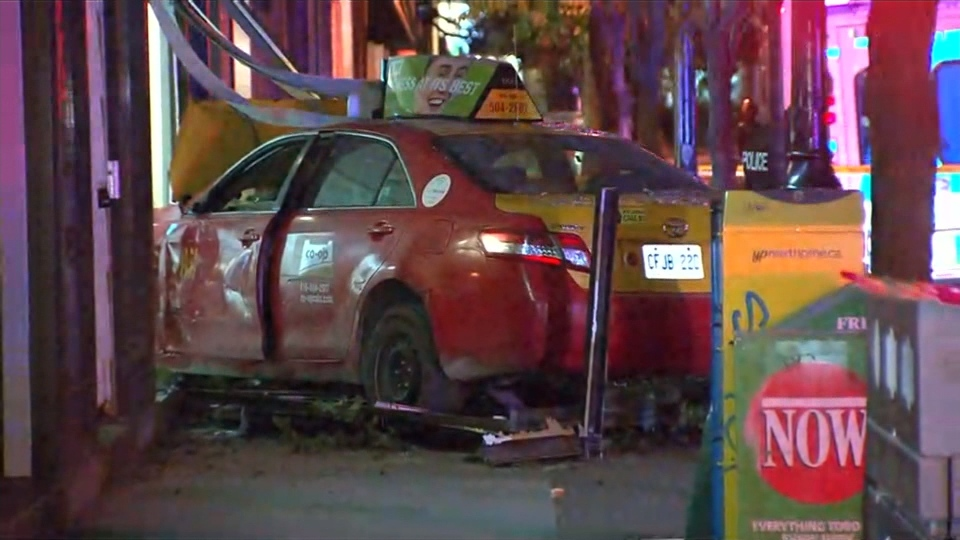 A taxi that slammed into a building on Adelaide Street East early Thursday morning is shown.
