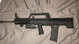 A Norinco OBZ assault-style rifle seized by police is shown in a TPS handout image.