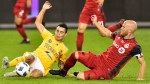 UANL Tigres midfielder Lucas Zelarrayan (8) and Toronto FC midfielder Michael Bradley (4) slide to the ball during second half Campeones Cup soccer action in Toronto on Wednesday, Sept. 19, 2018. THE CANADIAN PRESS/Frank Gunn