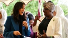"""Meghan, the Duchess of Sussex, left, reacts with one of the women behind the cookbook """"Together"""" during a reception at Kensington Palace, in London, Thursday Sept. 20, 2018. Markle was joined by her mother for the launch of a cookbook aimed at raising money for victims of the Grenfell fire. The reception was also attended by her mother Doria Ragland and husband Prince Harry. (Ben Stansall/Pool Photo via AP)"""
