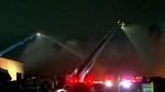 Emergency crews are seen battling a fire in Mississauga on Thursday night.