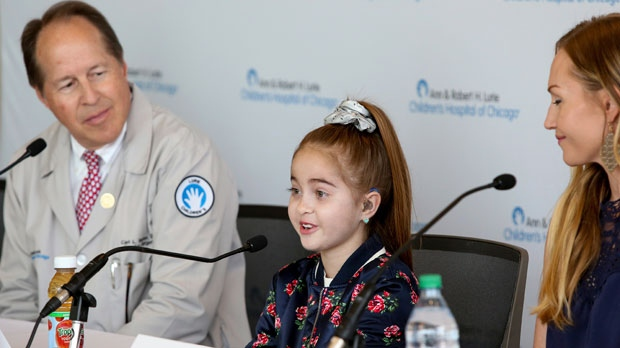 Heart transplant recipient Sofia Sanchez, talks with reporters at Ann & Robert H. Lurie Children's Hospital Thursday, Sept. 20, 2018, in Chicago. Sanchez captured the nation's attention in August when her two birthday wishes came true within a week of each other, a visit from rap star Drake and a life-saving heart transplant. At left is Dr. Carl Backer, one of her surgeons at Lurie Children's Hospital. At right is her mother, Natalie Sanchez. (AP Photo/Teresa Crawford)