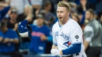 Toronto Blue Jays designated hitter Justin Smoak (14) reacts after hitting the game winning walk off home run to debated the Tampa Bay Rays during ninth inning AL baseball action in Toronto on Thursday, September 20, 2018. THE CANADIAN PRESS/Nathan Denette