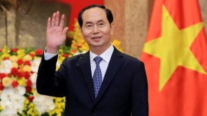 In this March 23, 2018, file photo, Vietnamese President Tran Dai Quang greets journalists as he waits for arrival of Russian Foreign Minister Sergei Lavrov at the Presidential Palace in Hanoi, Vietnam. Official media say Vietnamese President Tran Dai Quang has died at age 61 due to illness on Friday, Sept. 21, 2018. (AP Photo/Minh Hoang, Pool, File)
