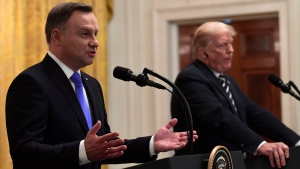 President Donald Trump, right, listens as Polish President Andrzej Duda, left, speaks during a news conference in the East Room of the White House in Washington, Tuesday, Sept. 18, 2018. (AP Photo/Susan Walsh)