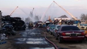 Water is shown being poured onto a scrap yard fire in Mississauga on Friday morning. (Cam Woolley)