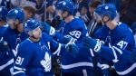 Toronto Maple Leafs' John Tavares is congratulated by teammates following his goal on the Buffalo Sabres during first period NHL action in Toronto on Friday September 21, 2018. THE CANADIAN PRESS/Frank Gunn