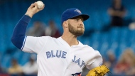 Toronto Blue Jays starting pitcher Sean Reid-Foley throws against the Tampa Bay Rays in the first inning of their American League MLB baseball game in Toronto on Friday September 21, 2018. THE CANADIAN PRESS/Fred Thornhill