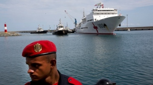 """Chinese navy hospital ship """"The Peace Ark"""" arrives at the port in la Guaira, Venezuela, Saturday, Sept. 22, 2018. The stop by the People's Liberation Army Navy's ship is the latest in an 11-nation """"Mission Harmony"""" tour and will provide free medical treatment for Venezuelans. (AP Photo/Ariana Cubillos)"""