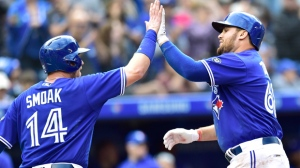 Toronto Blue Jays Rowdy Tellez (right) celebrates his two-run home run with teammate Justin Smoak during fourth inning American League baseball action against the Tampa Bay Rays in Toronto, Saturday, Sept. 22, 2018. THE CANADIAN PRESS/Frank Gunn