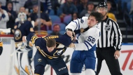 Buffalo Sabres right wing Tyler Randell, left, fights with Toronto Maple Leafs left wing Emerson Clark (58) during the second period of an NHL preseason hockey game in Buffalo, N.Y., Saturday, Sept. 22, 2018. (AP Photo/Adrian Kraus)