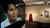 "In a photo from Friday, Sept. 21, 2018, in Detroit, an exhibit at the Charles H. Wright Museum of African American History features a ""tribute to the Queen of Soul."" ""THINK"" opens to the public Tuesday at the museum that hosted Aretha Franklin's public visitations after her death last month. It features archival photographs, videos and the red shoes she wore at her first visitation that drew global attention. (AP Photo/Carlos Osorio)"