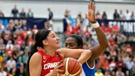FILE - In this Aug. 16, 2015, file photo, Canada's Natalie Achonwa, left, elbows Cuba's Clenia Noblet Salazar during first half action of the 2015 FIBA Americas Women's Championship Final in Edmonton, Alberta. Achonwa, had a breakout season for the Indiana Fever this year, is part of the young core for Canada that also includes other WNBA players Kia Nurse and Nayo Raincock-Ekunwe. (Jason Franson/The Canadian Press via AP, File)