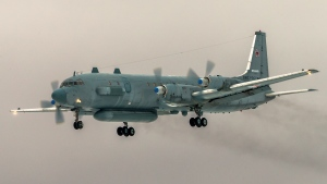 FILE- In this file photo taken on Saturday, March 4, 2017, The Russian Il-20 electronic intelligence plane of the Russian air force with the registration number RF 93610, which was accidentally downed by Syrian forces responding to an Israeli air strike flies near Kubinka airport, outside Moscow, Russia. The Russian Defense Ministry on Sunday Sept. 23, 2018, has renewed its accusations against Israel for causing the downing of a Russian military plane over Syria. (AP Photo/Marina Lystseva)