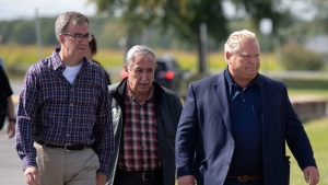 Ottawa Mayor Jim Watson, city councillor Eli El-Chantiry and Ontario Premier Doug Ford arrive at West Carleton High School, an emergency shelter for residents affected by a tornado, in Dunrobin, Ont., west of Ottawa, on Sunday, Sept. 23, 2018. The storm tore roofs off of homes, overturned cars and felled power lines in the Ottawa community of Dunrobin and in Gatineau, Que. THE CANADIAN PRESS/Justin Tang