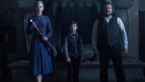"This image released by Universal Pictures shows Cate Blanchette, from left, Owen Vaccaro and Jack Black in a scene from ""The House With A Clock in Its Walls."" (Quantrell D. Colbert/Universal Pictures via AP)"