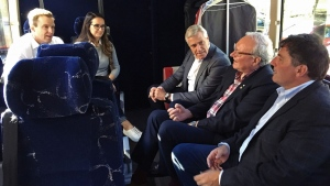 New Brunswick Liberal Leader Brian Gallant, left, and his wife Karine Lavoie are joined on the campaign bus by Newfoundland and Labrador Premier Dwight Ball, Prince Edward Island Premier Wade MacLauchlan and Intergovernmental Affairs minister Dominic LeBlanc in Moncton, N.B. on Sunday, Sept. 23, 2018.THE CANADIAN PRESS/Kevin Bissett