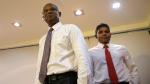 Maldives' opposition presidential candidate Ibrahim Mohamed Solih, left, and his running mate, Faisal Naseem, leave after addressing media in Male, Maldives, Monday, Sept. 24, 2018. A longtime but little-known lawmaker, Solih declared victory at his party's campaign headquarters in Male in a contentious election widely seen as a referendum on the island nation's young democracy. (AP Photo/Eranga Jayawardena)