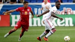 Toronto FC forward Jozy Altidore, right, controls the ball as New York Red Bulls midfielder Sean Davis applies pressure during the first half of a soccer game, Saturday, Sept. 22, 2018, in Harrison, N.J. (AP Photo/Julio Cortez)