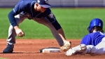 Toronto Blue Jays catcher Danny Jansen (9) is tagged out at second base by Tampa Bay Rays second baseman Brandon Lowe (35) during inning American League baseball action in Toronto, Sunday, Sept. 23, 2018. THE CANADIAN PRESS/Frank Gunn
