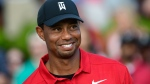 Tiger Woods stands on the 18th green after winning the Tour Championship golf tournament Sunday, Sept. 23, 2018, in Atlanta. (AP Photo/John Amis)