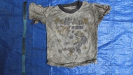 In this undated photo provided by the Veracruz State Prosecutor's Office shows clothing items found at the site of a clandestine burial pit in the Gulf coast state of Veracruz, Mexico. Veracruz state prosecutor Jorge Winckler said the bodies were buried at least two years ago and did not rule out finding more remains. He said investigators had found 114 ID cards in the field, which held about 32 burial pits. (Veracruz State Prosecutor's Office via AP)