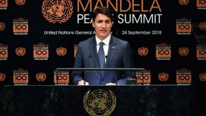 Prime Minister of Canada Justin Trudeau addresses the Nelson Mandela Peace Summit in the United Nations General Assembly, at U.N. headquarters, Monday, Sept. 24, 2018. (AP Photo/Richard Drew)