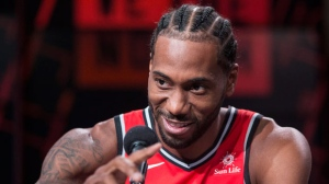 Toronto Raptors' Kawhi Leonard speaks to attends a press conference during media day in Toronto on Monday, September 24, 2018. THE CANADIAN PRESS/Chris Young