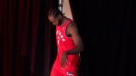 Toronto Raptors' Kawhi Leonard steps through a curtain as he appears before journalists for a press conference during media day in Toronto on Monday, September 24, 2018. THE CANADIAN PRESS/Chris Young
