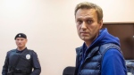 Russian opposition activist Alexei Navalny stands in a court room as he waits for a session in Moscow, Russia, Monday, Sept. 24, 2018. (AP Photo/Dmitry Serebryakov)