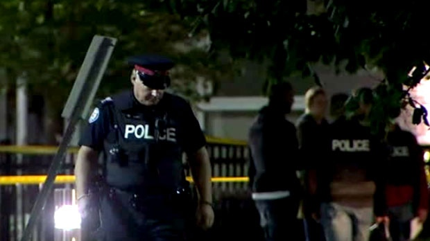 Toronto police are seen investigating a fatal shooting in North York on Monday night.