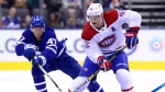 Toronto Maple Leafs left wing Pierre Engvall (47) and Montreal Canadiens centre Byron Froese (42) vie for the puck during first period NHL preseason action in Toronto, Monday, Sept. 24, 2018. THE CANADIAN PRESS/Frank Gunn
