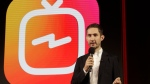 FILE - In this Tuesday, June 19, 2018, file photo, Kevin Systrom, CEO and co-founder of Instagram, prepares for an announcement about IGTV in San Francisco. (AP Photo/Jeff Chiu, File)