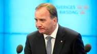 Swedish Prime Minister Stefan Lofven speaks to the media after losing a vote of confidence in the Swedish Parliament Riksdagen, Tuesday Sept. 25, 2018. Stefan Lofven, the leader of the Social Democratic Party, will continue as caretaker prime minister until a new government can be formed. (Anders Wiklund/TT via AP)
