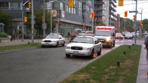 Police cruisers are shown at the scene of a fatal shooting near Sackville and St. Bartholomew streets on Tuesday afternoon.