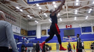 "Raptors guard Norman Powell dunks during training camp at the CARSA (Centre for Athletics, Recreation and Special Abilities) at the University of Victoria in Victoria, B.C., on September 26, 2017. Norm Powell is a big fan of three-a-day workouts. But three workouts within six hours? The Toronto Raptors combo guard arrived at training camp in the ""best shape of my life"" after a gruelling off-season training regimen of back-to-back-to-back workouts. His rest between sessions was the drive between gyms. THE CANADIAN PRESS/Chad Hipolito"