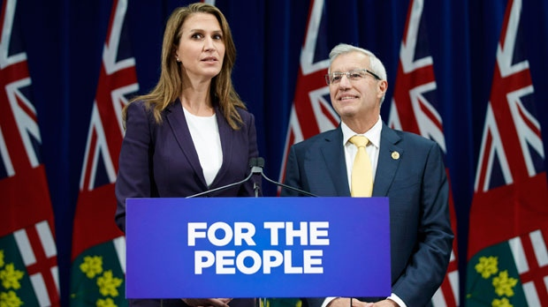 Ontario's Attorney General Caroline Mulroney and Minister of Finance Vic Fedeli speak about new legislation for selling marijuana, in Toronto, Wednesday September 26, 2018. THE CANADIAN PRESS/Mark Blinch